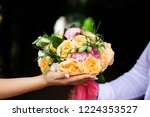 bride holding her bouquet | Shutterstock . vector #1224353527