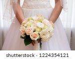 bride holding her bouquet | Shutterstock . vector #1224354121