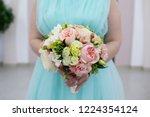 bride holding her bouquet | Shutterstock . vector #1224354124