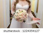 bride holding her bouquet | Shutterstock . vector #1224354127