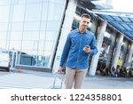 handsome adult man holding... | Shutterstock . vector #1224358801