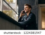 happy man standing by the...   Shutterstock . vector #1224381547