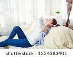 girl in headphones smiling... | Shutterstock . vector #1224383401