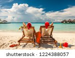 couple on a tropical beach in... | Shutterstock . vector #1224388057