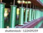 reels of green silk threads... | Shutterstock . vector #122439259