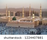 Small photo of Medina Mosque, Saudi Arabia. Muslims from different countries worship in the courtyard of the Prophet's mosque. The Prophet Mosque is the second sacred mosque in the world.