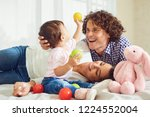 happy family playing with the... | Shutterstock . vector #1224552004