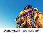 happy couple making selfie on a ... | Shutterstock . vector #1224587584