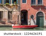 red wooden boat moored in front ... | Shutterstock . vector #1224626191