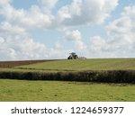 tractor on the horizon ... | Shutterstock . vector #1224659377