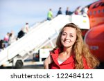 happy young woman in airport... | Shutterstock . vector #122484121