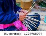 hands working in a basket .hand ...   Shutterstock . vector #1224968074