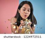 happy asian woman blowing... | Shutterstock . vector #1224972511