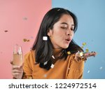 happy asian woman holding... | Shutterstock . vector #1224972514