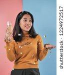 happy asian woman holding... | Shutterstock . vector #1224972517