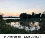 lakeside during sunset | Shutterstock . vector #1225024684