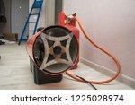 repairmen install stretch... | Shutterstock . vector #1225028974