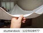 repairmen install stretch... | Shutterstock . vector #1225028977