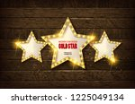 large wooden star with a large... | Shutterstock . vector #1225049134