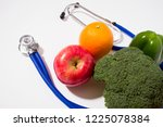 stethoscope with fruits and... | Shutterstock . vector #1225078384