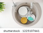 heap of dirty dishes in kitchen ... | Shutterstock . vector #1225107661