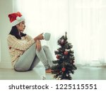 asian woman wearing santa hat... | Shutterstock . vector #1225115551