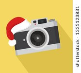 flat vintage camera with hat... | Shutterstock .eps vector #1225123831