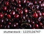 dark cherries background | Shutterstock . vector #1225126747