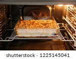 crumble cake in the owen with... | Shutterstock . vector #1225145041