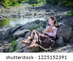 young girl in a boho style... | Shutterstock . vector #1225152391