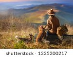 woman traveler with her dogs... | Shutterstock . vector #1225200217