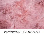 pink sheepskin background. fur... | Shutterstock . vector #1225209721
