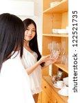 attractive asian women choosing ...   Shutterstock . vector #122521735