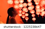 woman look at the red lantern... | Shutterstock . vector #1225238647