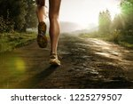 runner on a forest path | Shutterstock . vector #1225279507