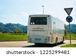 white tourist bus on the road... | Shutterstock . vector #1225299481