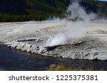 cliff geyser at the black sand... | Shutterstock . vector #1225375381