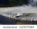 cliff geyser at the black sand... | Shutterstock . vector #1225375384