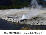 cliff geyser at the black sand... | Shutterstock . vector #1225375387