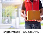 customer receiving a delivery... | Shutterstock . vector #1225382947