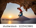 male rock climber hanging with... | Shutterstock . vector #1225415881