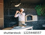 skilled chef preparing dough... | Shutterstock . vector #1225448557