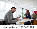 job interview. employer reading ... | Shutterstock . vector #1225451104