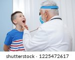 kid with opened mouth looking... | Shutterstock . vector #1225472617