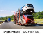 cars carrier truck at the... | Shutterstock . vector #1225484431