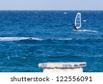 windsurfing on a sunny day | Shutterstock . vector #122556091
