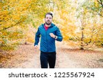 young runner doing jogging... | Shutterstock . vector #1225567924