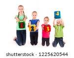 happy kids holding blocks with...   Shutterstock . vector #1225620544