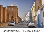 autos near ancient great mosque ... | Shutterstock . vector #1225715164