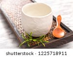 white ceramic teacup on an old... | Shutterstock . vector #1225718911